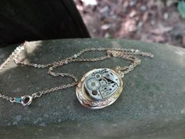 Steampunk gear locket by Hiddendemon-666