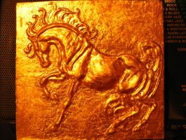 Gold horse basorelief by Winnetah