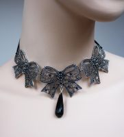 Cute bows necklace by Pinkabsinthe