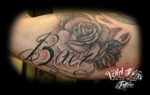 Name with rose by WildThingsTattoo