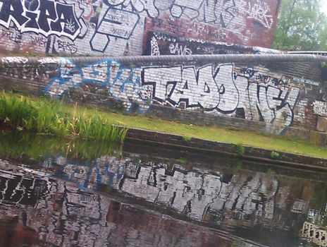 Graffiti in the Winson Green Canal 2 by desbest