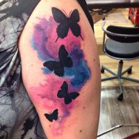 Tribal Butterflies with Watercolor tattoo by IAteAllMyPaste