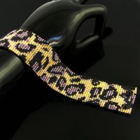 Wild leopard bead loomed cuff by CatsWire