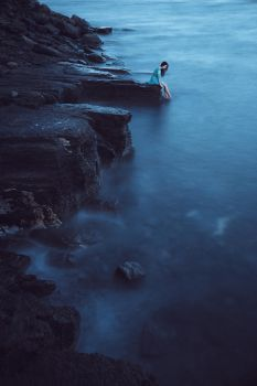 Young woman on sea in twilight. Long time exposure by Black-Bl00d