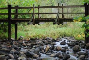 Bridge Over Rocky Waters by Velendron
