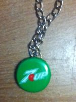 Butterfree 7up lid necklace (back) by Pikachunyan