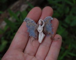 Feather a tiny faerie by chicorydell