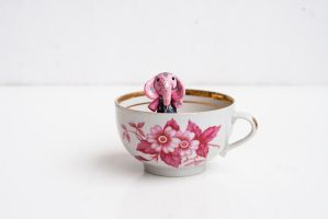 Miniature pink elephant with lilies. by freedragonfly