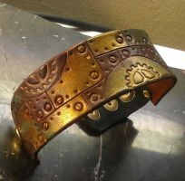 Clockwork metallic leather bracer by StudioGruhnj