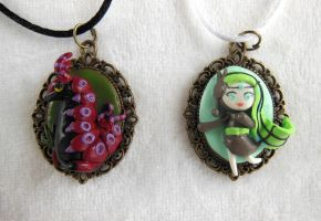 Meloetta and Scolipede Cameo Necklace by LittleBreeze