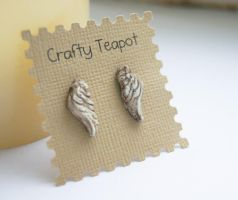 Distressed ivory angle wing ear studs by ButtonxMushroom