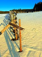 Leading fence line in winter wonderland by patrickjobst