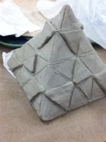 clay project(design: repeated triforce symbol) by XanderCakes