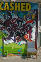 Graffiti Wall with Chair by happeningstock