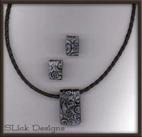 Black Leather and Clay Pendant by SLiCkDesigns