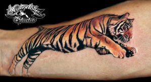 photorealistic tiger tattoo by Newagetattoo