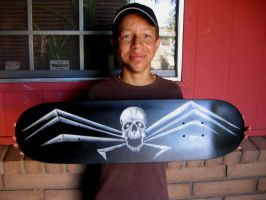 Zach with his skateboard by Decarabia69