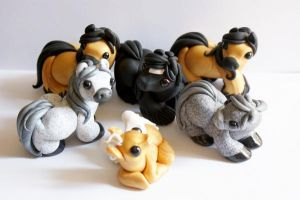 Herd of little clay horses by crystalcookart