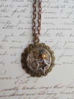 Steampunk necklace with star and small gears by SteamJo
