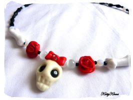 Cute Skull Necklace by Cateaclysmic