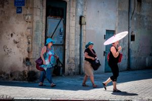 Walking under the sun in Jaffa by Rikitza