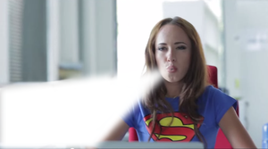 Supergirl shows a secret to the intern by Superbreath