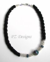 Untitled Asymmetrical Necklace by PurlyZig