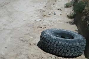 Tire on the road by X5-Stock
