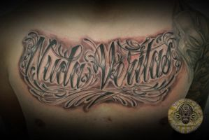 chicano writing nuda veritas by 2Face-Tattoo