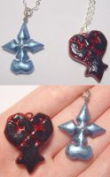 Heartless and Nobody Pendants by wickedorin