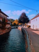 The river through the village center by patrickjobst