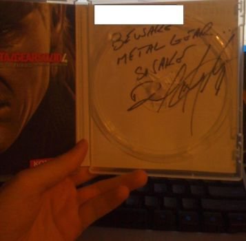 My signed copy of MGS4 by Muzakcube64
