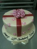 Rosey Present Cake by Spudnuts