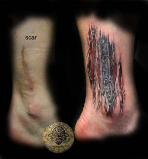 Cover_scar_muscle_tattoo_by_2Face_Tattoo.jpg