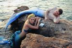 Merman and Mermaid on the rocks by stomper105