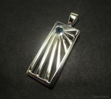Blue topaz starburst pendant. by Dans-Magic