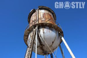 Abandoned Small Water Tower by Containement