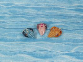 Charms: Cuttlefish by okapirose