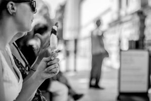 A woman and her ice lolly. by JSWoodhams