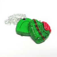 Zombie heart locket by Devilish--Designs