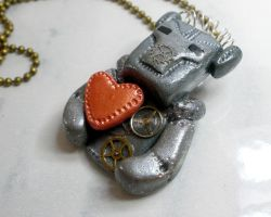 Robot with heart necklace by Brisbykins