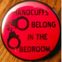 HANDCUFFS BELONG IN THE BEDROOM pinback button by crizzlesbuttons