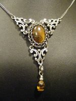 framed persian tigers eye in silver necklace by BacktoEarthCreations