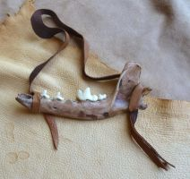 Custom coyote jawbone talisman by lupagreenwolf