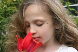 Girl Smelling Red Flower 4 by rachellcoe