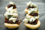 Red Onion Chutney and Blue Cheese Canapes by iconsPhotography