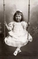 Vintage little girl in swing 002 by MementoMori-stock