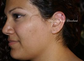Cartilage piercing by Chelsea by SmilinPirateTattoo