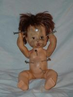 doll with nails in its head 4 by JensStockCollection