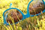 My blue sunglasses in the grass by MilanVopalensky